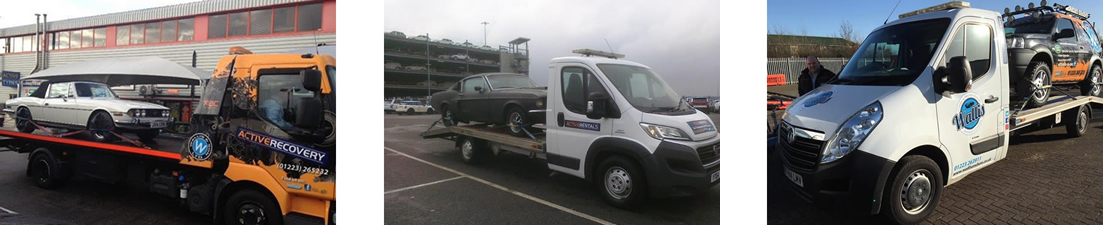 Images of some cars being transported by wallis car transporters.